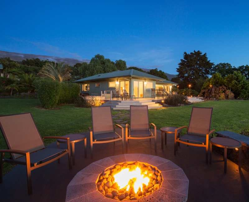 chairs sitting around fire pit on patio